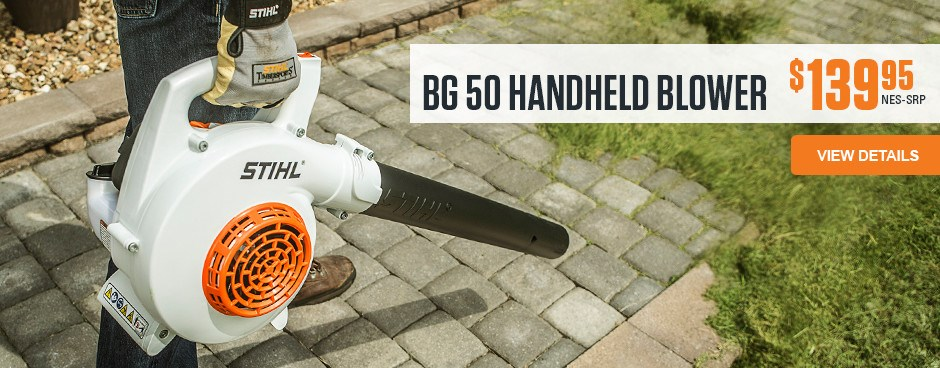 BG 50 Handheld Blower removing grass trimming